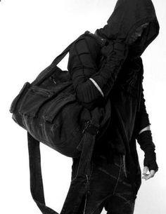 patchwork black hoodie, patchwork gauntlets, canvas duffel.