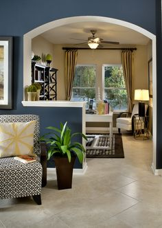 Love the half wall to slightly separate the home office from the living space. Great wall color!