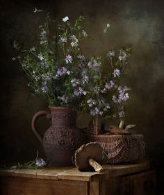 so pretty with the pottery pitcher and basket of mushrooms
