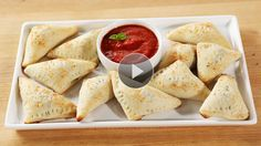 Watch our #tutorial for these make-ahead mini #spinach #calzones.