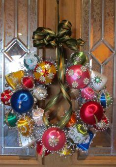 My new wreath made with my grandma's satin ball ornaments.