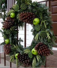 colonial williamsburg Christmas wreath with sugar pine cones wheat and lotus pods