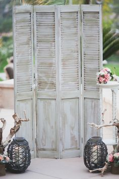 """You could take something vintage like these shutters and drape them with cherry blossom """"vines"""" and put it behind the dessert display or altar or guest book area. You could hang pictures on the shutters or candles or more flowers."""