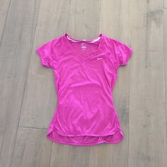 NWOT Nike running top New and never worn. Super soft. Running pocket on back to hold small items. Nike Tops Tees - Short Sleeve