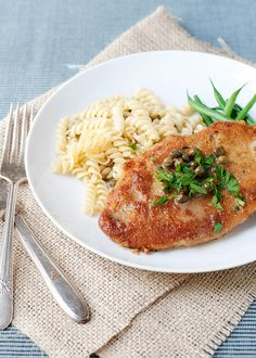 Chicken Piccata  2 – 4 chicken breasts, split in half   2 cups bread crumbs   2 eggs   salt and pepper   1 stick butter   4 Tablespoons olive oil   1/3 cup lemon juice   1/2 cup chicken stock   1/4 cup capers   1/4 cup parsley