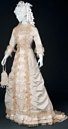 Wedding dress, 1874. Silk with gathered front panel trimmed in lace. Courtesy of Steven Porterfield, photo by Laurie Ruth Photography. Univ. of North Texas