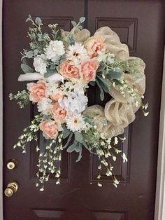 Beautiful cream deco mesh wreath with a white bird and peach