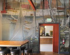 A nostalgic photograph of Baltimore water life was used on the wall that separates the main dining area from the  espresso bar inside The Chesapeake. The new operators said they didn't want to overdo a nautical theme.