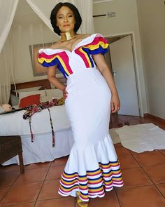 Image may contain: 1 person, standing Venda Traditional Attire, Sepedi Traditional Dresses, African Traditional Wedding Dress, Traditional African Clothing, Traditional Weddings, Xhosa Attire, African Attire, African Wear, Latest African Fashion Dresses