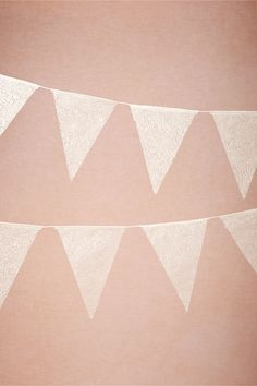 Cute for around the bar area: Lace Pennant Garland (3) in Décor View All Décor at BHLDN