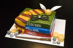 HARRY POTTER CAKE. AWESOME. except put actual hogwarts books instead of random stuff