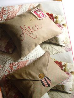 "Envelope Cushion from ""Everything Alice: The Wonderland book of makes, by Hannah Read-Baldrey and Christine Leech."""
