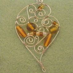 Artistic form wire wrapped heart, amber glass beads silver necklace | craftybabyhope - Jewelry on ArtFire