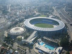 The stadium in Rio was originally built for the 1950 Fifa World Cup. The stadium is better known as the Maracana and once was the largest in the world with a capacity of 200,000. It is the second most popular tourist attraction in Rio de Janeiro. Before the 2014 World Cup, refurbishments to the Maracana include expanded access ramps, a new roof and the replacement of all seating. There is a large train station behind the stadium which will be the main way to get to and from matches.