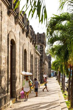 Condé Nast Traveler - 30 Warm Places We'd Rather Be Right Now - Nicaragua From the colorful colonial town of Granada to surfing mecca San Juan del Sur, Nicaragua is emerging as the style set's favorite destination. (Pictured: The castle-like walls of El Viejo Mercado, or the Old Market, in Masaya.) —Maura Egan Read more: Nicaragua's Rainbow-Colored Cities © Julien Capmeil