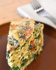 "In this take on baked pasta, ricotta and eggs are mixed together to make a creamy, custardy sauce for ziti, spinach, and roasted red pepper. The ""cake"" gets its shape from a springform pan."