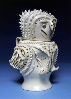 Maker: Unknown; pottery Collection: J.W.L. Glaisher Category: stoneware Name(s): owl jug white salt-glazed stoneware; category Date: circa 1730 — circa 1750 School/Style: Rococo Period(s): mid 18th Century; George II