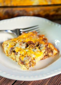 Sausage Breakfast Casserole Recipe - sausage, bread, swiss and cheddar cheese, eggs, milk, Worcestershire and dijon. Make ahead of time and refrigerate 8 to 24 hours. Great for overnight guests! We also like to eat it for dinner.