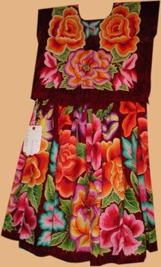 From Oaxaca, a Tehuana skirt and top of cotton embroidered velvet. All hand done, from the 1940's