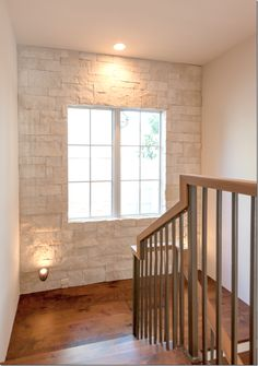 :: Havens South Designs :: loves this custom home by Houston's David James Palmore Construction. Love the back wall of stairway done in stone.