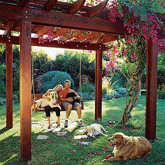 Like humans, dogs enjoy basking in the sun. So by all means, give them a deck or a patch of lawn for sunbathing. But remember that dogs can overheat easily, so it's even more important to provide them with cooling retreats. Here, 4 retrievers (liko, Lexi, Andy, and Morgan) enjoy resting under an arbor in Oceanside, CA. More: See how to make a simple square pergola (Photo: Thomas J. Story )