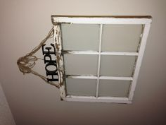 six paned window with twine and word hope