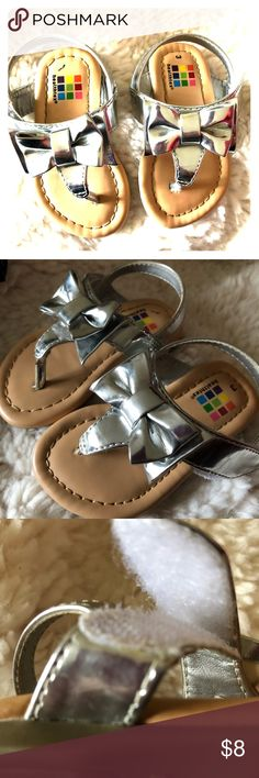 Adorable silver sandals Add shimmer and shine to your babies outfit with these adorable shiny silver sandals .  Excellent shape, not even sure they have been ever worn !   So so cute 💕. Don't forget to bundle and save . Healthtex Shoes Sandals & Flip Flops