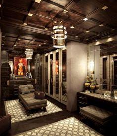 Luxury Master Closets glam black closet features a black closet island adorned with