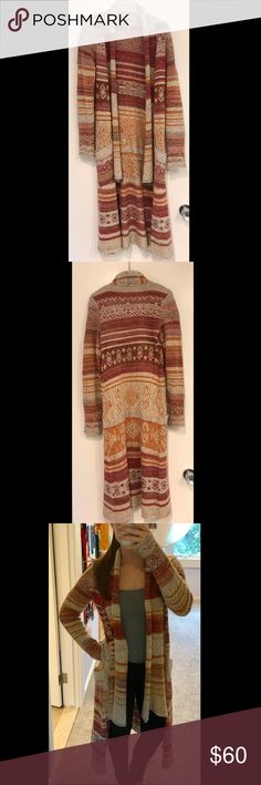 Free people robe cardigan sweater Free people red, orange, brown, and cream sweater robe. Size small. Very warm. In great condition, only worn a few times. Super cute for fall Free People Sweaters Cardigans