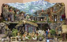 Magnificent nativity displays I grew up admiring through windows during the evening strolls as a child holding the hand of my grandmother.  Brings back beautiful memories.