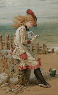 Young girl on beach reading