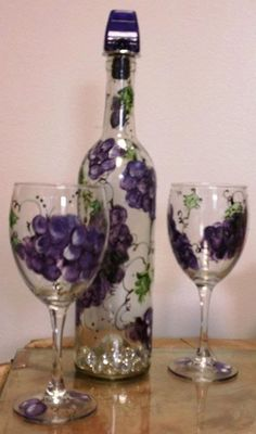 Hand painted wine bottle and wine glass set. Grape details on all three pieces. Glassware is completely washable and useable. Bottle $24 Set of glasses $24