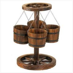 Wagon Wheel Planter by Furniture Creations. Save 41 Off!. $58.99. Wagon wheel designMade of wood18 1/2 x 23 1/2 inches high. The western themed outdoor décor battle was won with weapons like this gorgeous wagon wheel planter.  You won?t find an accent better suited to those who love natural materials, and rustic designs than this! With a wheel base and top and four bucket/planters suspended by chains, they?ll have a whole passel of places to plant their petunias! Wood is the in material...