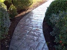 Example of a concrete impress pathway we can install at your home. Info@nevermowuk.co.uk