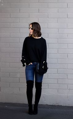 Tie Sleeve Sweatshirt: How to Actually Look Chic In a Crewneck | Clothes & Quotes. Black sweatshirt+skinny jeans+black over the knee boots+black chain shoulder bag+aviator sunglasses. Winter Transition to Spring Casual Outfit 2017