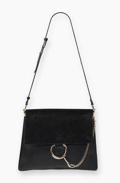 Chloe Faye Shoulder Bag // The Faye is the perfect expression of refined femininity with a modern edge. Flawless combinations of sumptuous leathers are pierced with cool hardware for subtle glam rock flair. Effortlessly elegant, the clean lines of this supple clutch are complemented by the roundness of its bold ring and pendent chain.