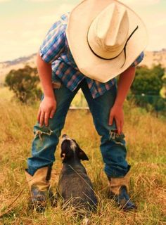 plaid, hat, ripped jeans, boots and a dog....yup thats a country boy