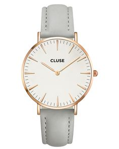 Cluse Cluse La Boheme Grey & Rose Gold Watch: This Cluse La Bohème model features an ultra-thin case with a 38 mm diameter, crafted with precision for a sophisticated and elegant result. White and Rose Gold are combined with a Grey leather strap, detailed with a silver clasp.