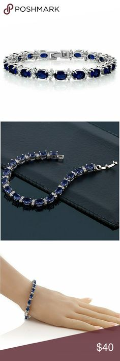 """20.00 Ct Oval & Round Blue CZ 7"""" Tennis Bracelet 20.00 Ct Oval & Round Blue CZ Tennis Bracelet 7""""  - Oval and Round Blue Cubic Zirconias makes this bracelet beautiful and romantic all at once! This bracelet is a truly outstanding piece that belongs in every jewelry collection. - CARAT TOTAL WEIGHT - 20.00 CT - 7 Inch Tennis Bracelet - Rhodium plated Jewelry Bracelets"""