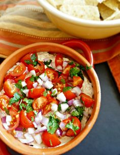 A Mexican Dip that is easy to pull off and uses all natural ingredients. It is always the first thing to disappear from the buffet table.