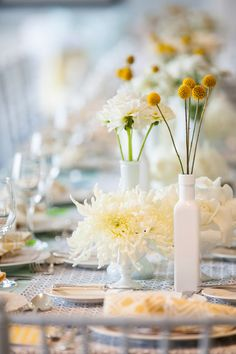 #tablescapes, #centerpiece, #white, #yellow  Photography: Maya Myers Photography - mayamyers.com  Read More: http://www.stylemepretty.com/living/2014/01/06/smp-living-graphic-print-inspired-baby-shower/