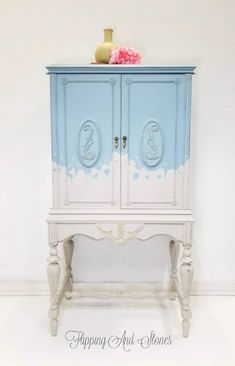 Take a look at this beauty! This old radio cabinet has been transformed into a work of art! Painted in a dreamy blue and silky cream, this piece will standout in any room in your home. The versatility of this cabinet is astounding. It's the perfect size for storing linens or add this cabinet to your bathroom which will allow you to store your bathroom supplies in style . Use it as a statement in your entry way to display your precious family memories.
