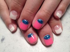 Simple French with two accent nails with a blue sparkle base and a pink French line