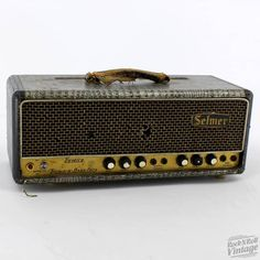 My very first amp, cost me $35 - a '65 Selmer Treble n Bass Fifty Head w/ metallic Croc Skin Tolex and matching 2x12 cab....K