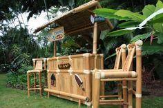 """""""Big Kahuna"""" Tiki Bar w/ 3 Stools - Outdoor Tiki Bar Surf Style by Tikimaster. $1180.00. Big Kahuna Tiki Bar: comes with all accessories - You save $100!  TROPICAL DECOR Imagine yourself sipping a Mai Tai, Strawberry Daiquiri or other cool tropical drink by the pool while seated at your own authentic Tiki bar! Hand constructed from high quality bamboo & hardwoods, these sets are sturdy as well as beautiful . Roof panels are hand-crafted thatch. OurTiki bars include..."""