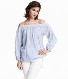 Blouse in airy, woven cotton fabric with elastication at upper edge. Open shoulders, long sleeves with elasticized cuffs, and drawstring at hem with decorative tassels.