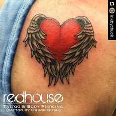 Heart with wings by Chuck Bush  at RedHouse Tattoo and Body Piercing Studio in Buffalo NY.