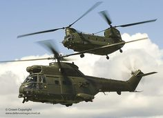 In close formation, a Royal Air Force Chinook (top) and Puma helicopter fly together in a shot entered for the RAF Photographic Competition of 2008.