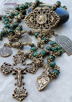 Virgin Mary Raphael Michael Lourdes Anthony Lord of Miracles Natural Emerald Ornate Antique style Bronze Rosary Love,Joy,Faith,loyalty Raphael Michael Lourdes Anthony Natural Emerald Bronze Rosary Catholic Jewelry, Rosary Catholic, Jil Sander, Gold Rosary, Rosary Beads, Prayer Beads, Saint Laurent, Lord, Elephant Necklace