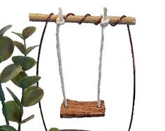 When we started making fairy gardens, we looked everywhere for the perfect swing and couldnt find one. Making our own was actually the start of